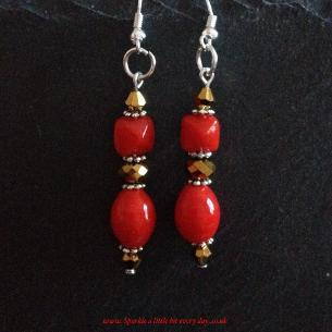 Red and gold drop earrings.