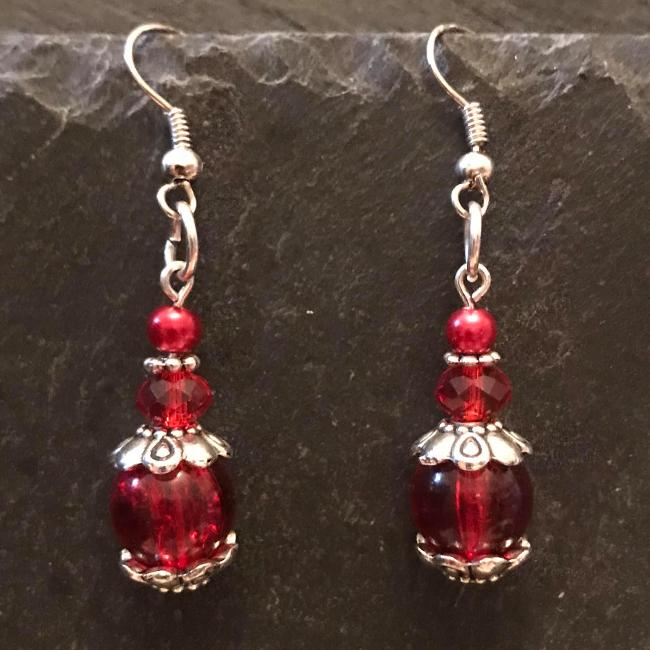 Red earrings made from glass beads and crystals.