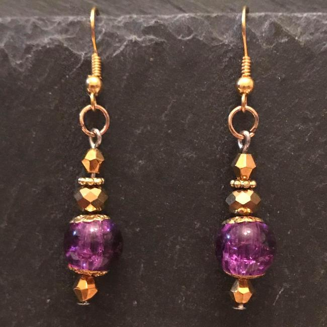 Purple earrings made from glass beads and crystals.