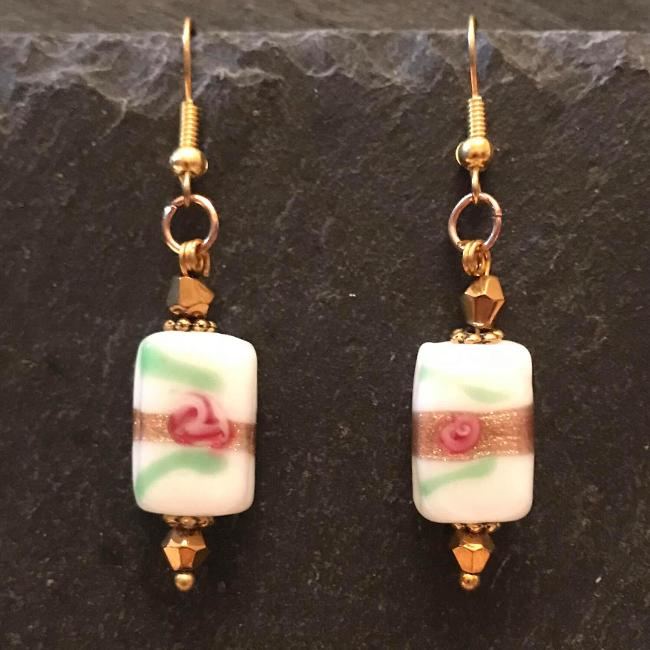 Gold earrings made from glass beads and crystals.