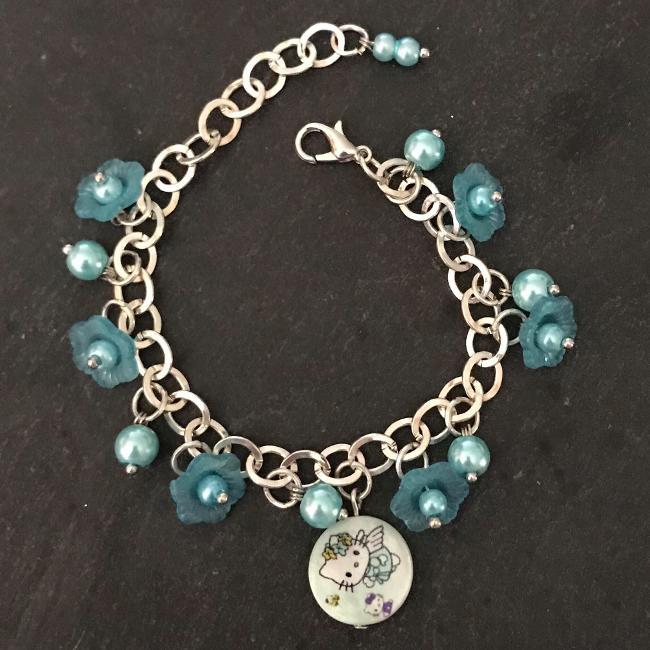 Turquoise flowers kitty child's bracelet.