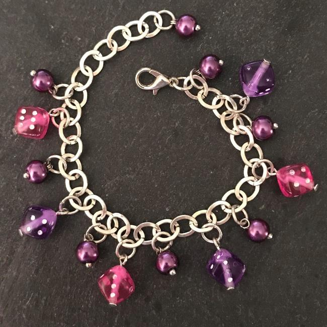 Pink and purple dice child's bracelet.