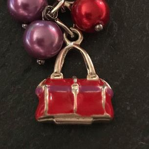 Close up view of a feature of the bag charm.