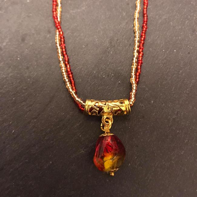 Red and Gold Glass Pendant on a double strand of seed beads.